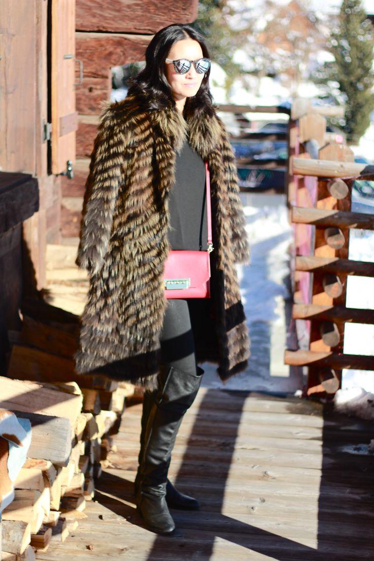 Shop this look on Lookastic:  http://lookastic.com/women/looks/sunglasses-fur-coat-sleeveless-top-crossbody-bag-skinny-jeans-over-the-knee-boots/7910  — White and Black Sunglasses  — Brown Fur Coat  — Black Sleeveless Top  — Red Leather Crossbody Bag  — Black Skinny Jeans  — Black Leather Over The Knee Boots