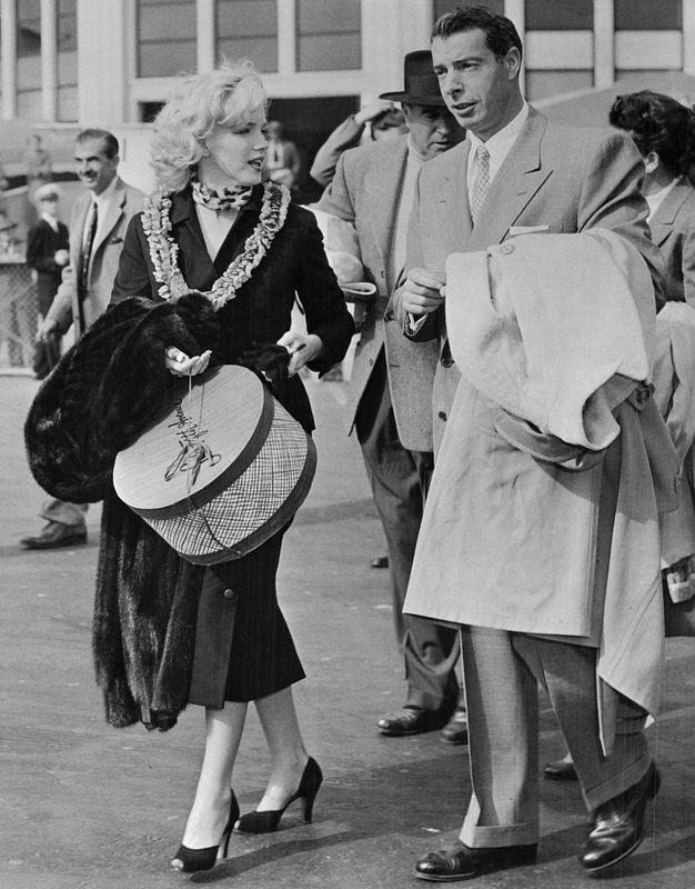 January 29, 1954 - San Francisco - Baseball great, Joe Di Maggio and wife, actress, Marilyn Monroe.