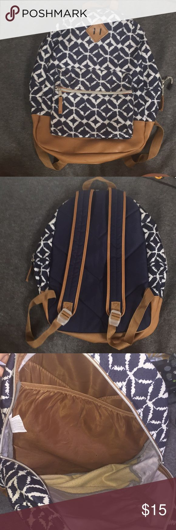 Backpack Blue and White backpack with leather detailing. Has a laptop slip inside the main pocket as well as a small pocket on the front. There's some wear on the straps (pictured at the end). Overall in great condition, just too small for all of my schoolbooks and binders. Bags Backpacks