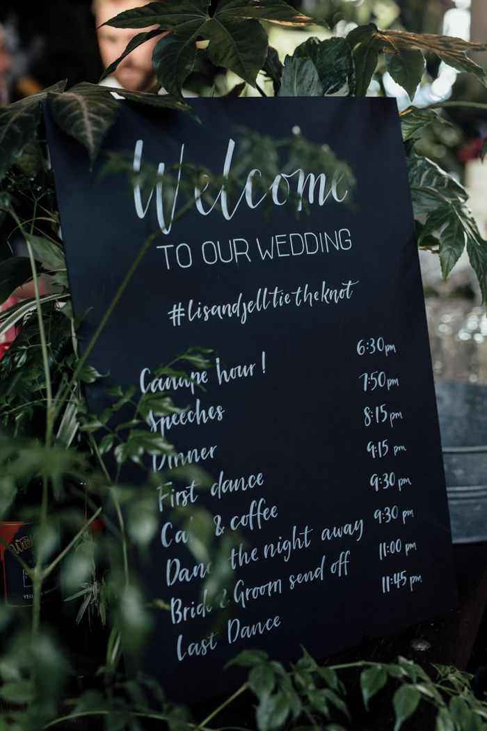 Black and white wedding timeline sign | Image by Free the Bird