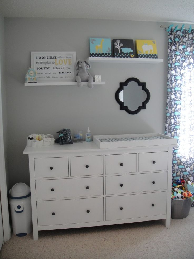 shelves over chaning table/dresser are very handy. nice spot for decor and keeping products out of little hands.