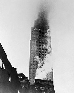 NYC. Vintage July 28, 1945, B-25 bomber crashes into the 78th floor of the Empire State Building on the north side in dense fog, //  www.RevWill.com