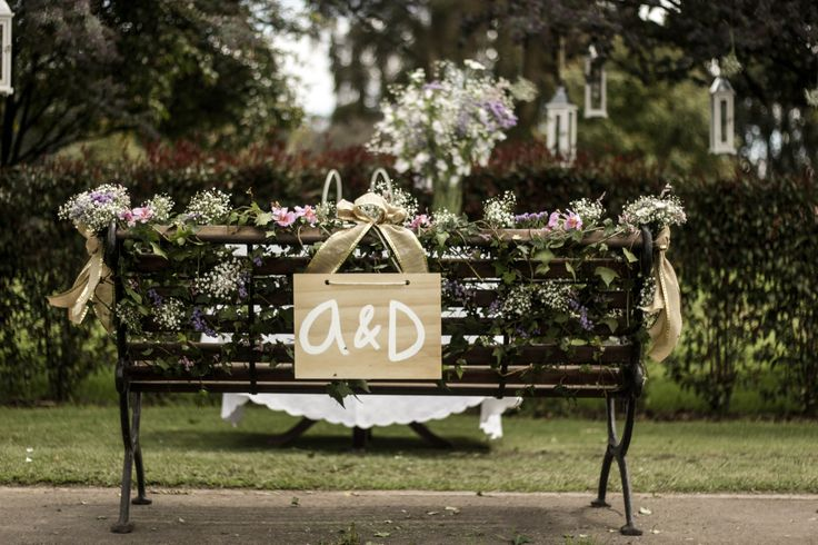 Bride and groom chair - decorated with flowers and wooden initial letters sign