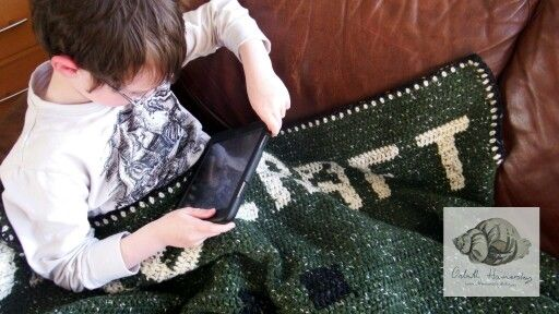 """Minecraft #gaming #blanket in action. Follow the blog here  http://blog.thewoolshop.ie/2015/02/minecraft-blanket-by-art-hamersly.html I wonder if I made one with """"Homework"""" on it would it have the same effect? #handmade #crochet #Yarn #design #pattern"""