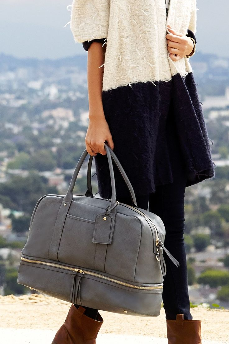 Roomy grey travel bag with a bottom shoe compartment. Perfect for weekend trips!