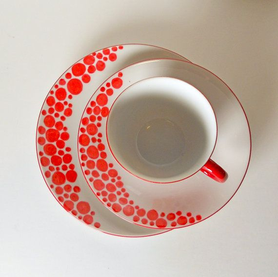 Hand painted cup, saucer, and plate. Very cute! Love the bright orange on white!