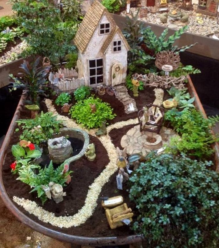 Don't throw out that tired or rusty old wheelbarrow, turn it into a fantastic Fairy Garden and add a magical touch to your home.  You can place it under a tree or create a beautiful backdrop for it. Add some twinkling lights for an extra special look. Be sure to view our collection of Broken Pot Fairy Garden ideas too, they're fun to make and so easy.