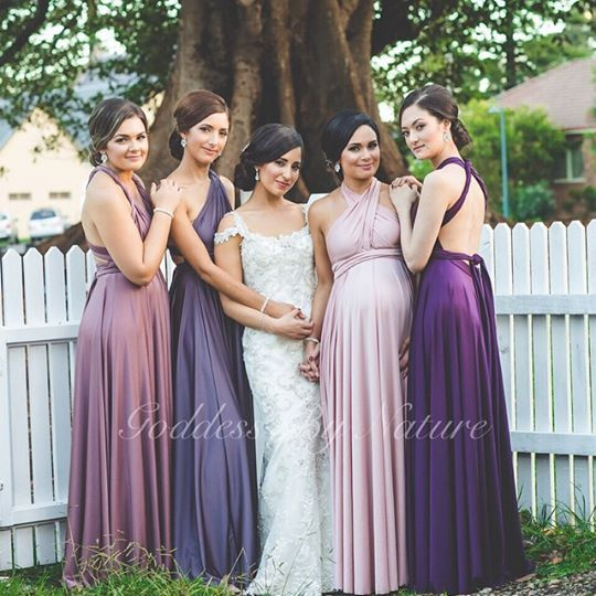 Stunning bride Priscilla with her gorgeous Goddess By Nature bridal party looking amazing in a beautiful colour palette of soft pinks to purples in their Goddess Signature Ballgowns  Available from NSW stockist Just Bridesmaids and Formals