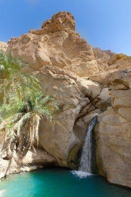 Waterfall in Oasis between the rocks tunisia. Panoramic view.