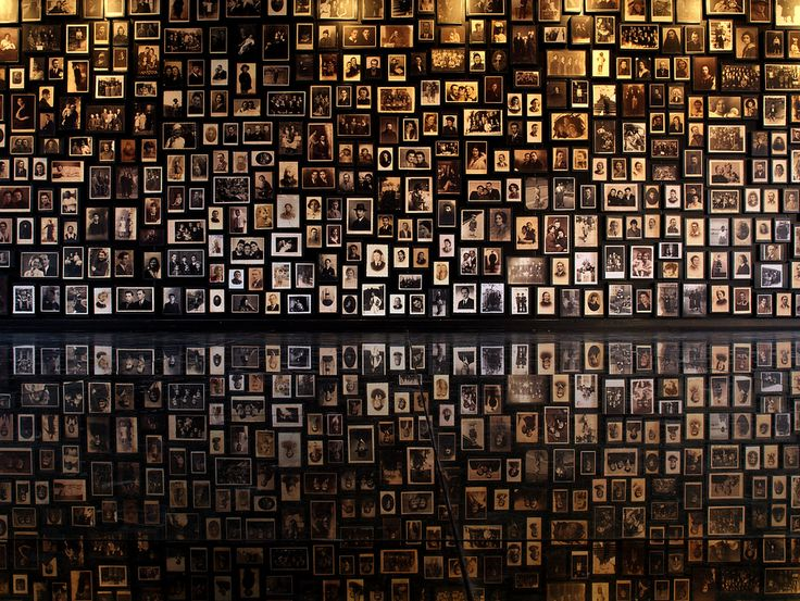 "A wall, showing portraits of the victims of Auschwitz concentration camp, located inside the ""bathhouse"" of the camp... the visit of this place is an indescribable expirience."