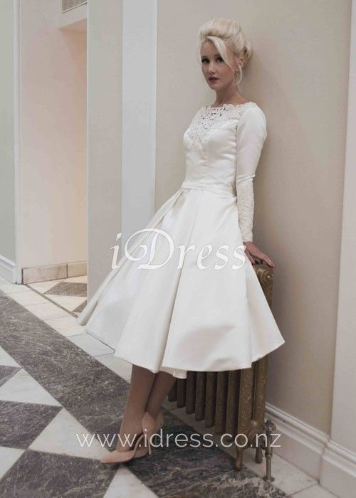 548f48c76230 Vintage and elegant, this ivory bridal dress is a sumptuous satin gown. A  short satin tea length wedding dress with long fitted sleeves.