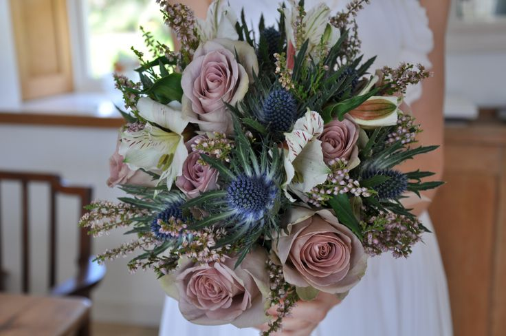 wild scottish bridal bouquet with thistles, amnesia roses and heather