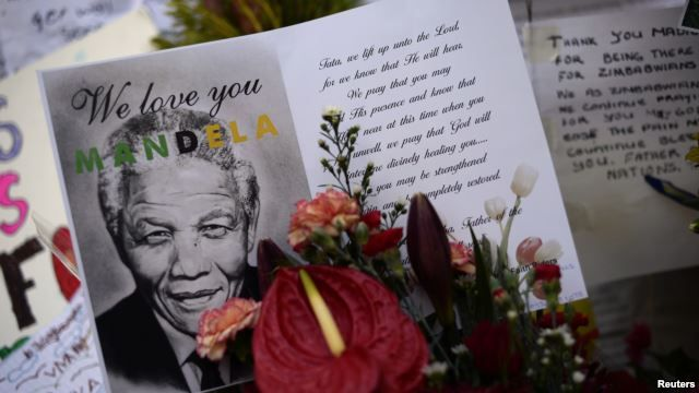 Cards and flowers are left outside the Medi-Clinic Heart Hospital, where the ailing former South African President Nelson Mandela is being treated in Pretoria, June 28, 2013.