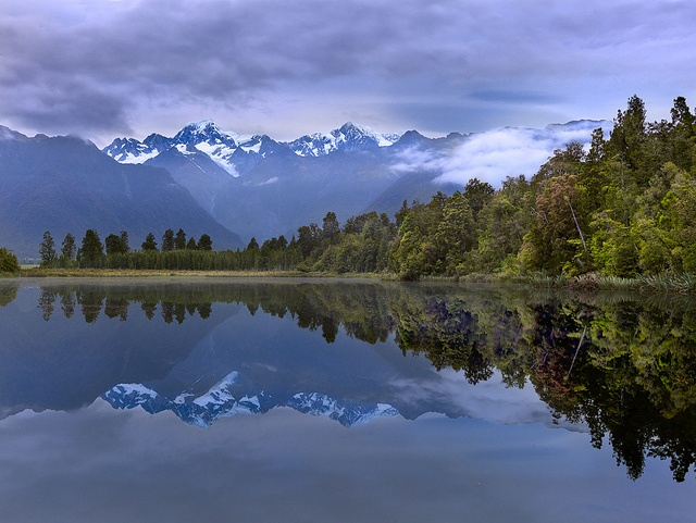 Lake Matheson, With a clear view of Mt Cook, this was taken on a quiet sunrise and the water was like glass. By Will Ophuis Photos. www.flickr.com/...