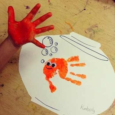 Fish handprint. Use with swim swim to talk about friendship words.