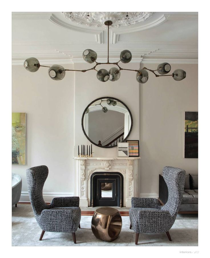 lindsey adelman light, modern wingback chairs, modern furniture in old architcture, fireplace
