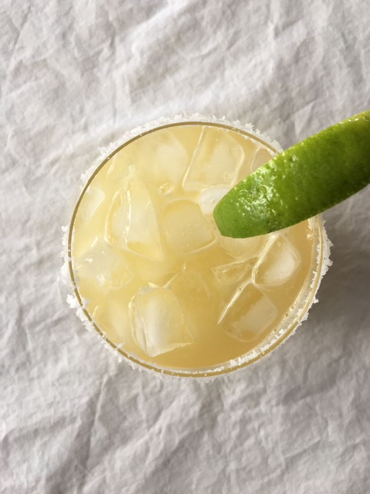 No matter what day it is, a margarita is never a bad idea. Never. Frozen,  skinny, on the rocks, sangria swirl, I love them all. We love margaritas so  much we tried our hand at making them ourselves without a pre-made sugary  mix. And the results were stupendous.  Simple Syrup - 1 cup of water - 2.5 cups of sugar - juice of half of a lemon Combine all ingredients in a saucepan on medium-high(ish) heat and bring to  a boil. Once it's boiling remove from heat and let it cool.  The Margarita…