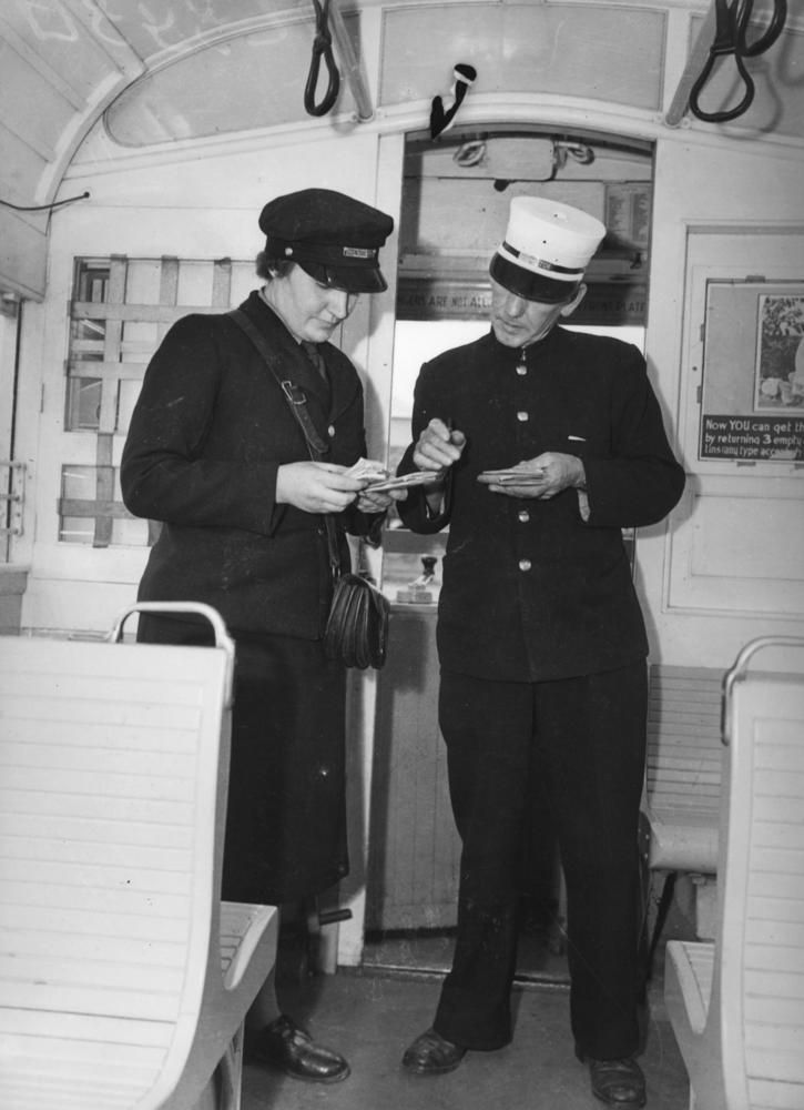 New tram conductress in training during World War II. Conductor's uniform was so smart - navy coat and trousers and  white kepi.