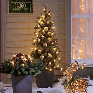 Porch tree pre lit from through the country door for Country living artificial christmas trees