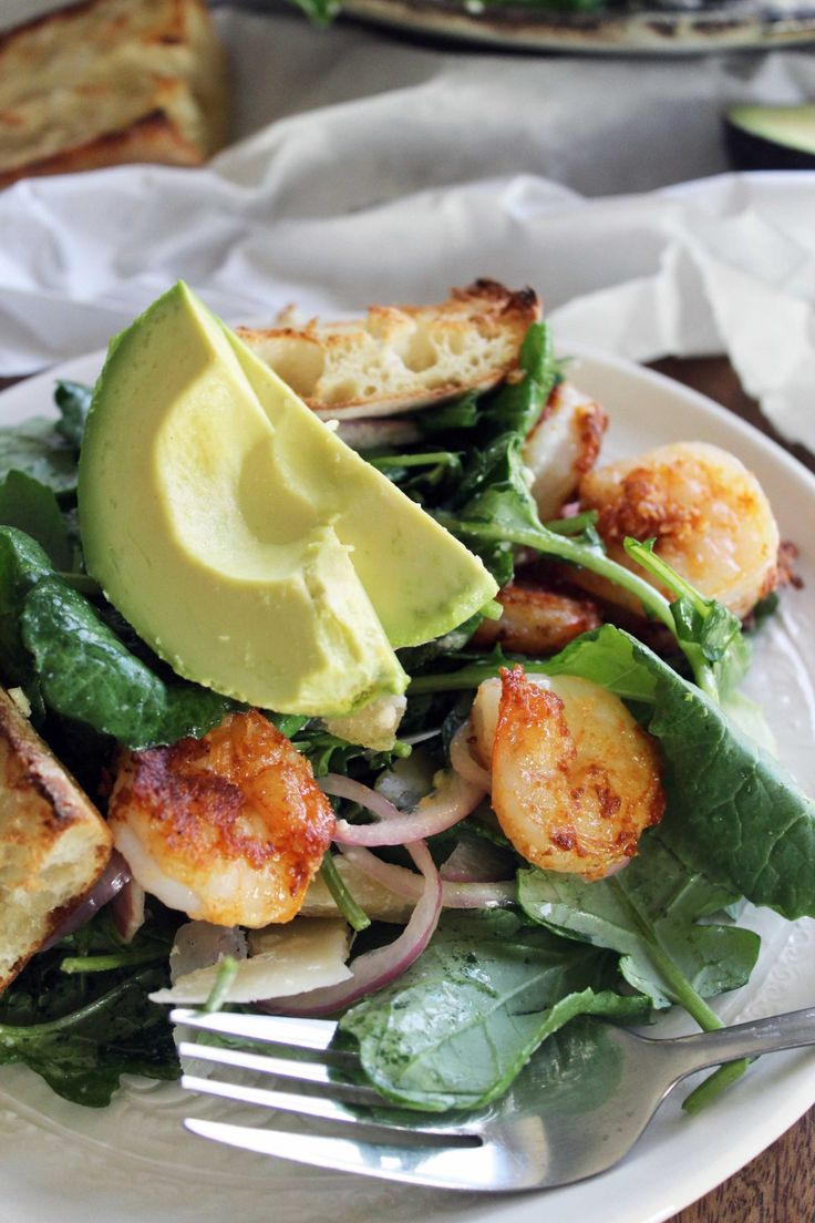KALE CAESAR WITH PARMESAN CRUSTED SHRIMP, PICKLED SHALLOTS, AND AVOCADO