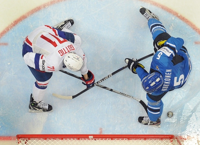 French Anthony Guttig (L) scores against team Finland, as Finnish Lasse Kukkonen tries to stop him during a preliminary round game of the IIHF International Ice Hockey World Championship in Helsinki on May 10, 2012. Team Finland won 7-1
