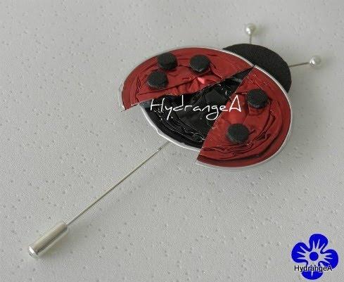 Nespresso-Ladybug pin/brooch