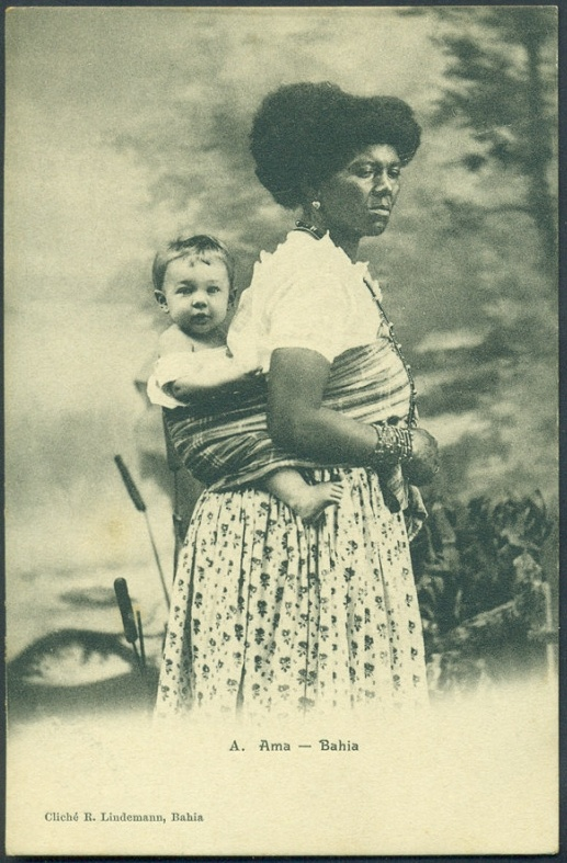 Brazil, 1880: slave woman carrying her master's baby in the traditional african way. Photo by Rodolpho Lindemann.