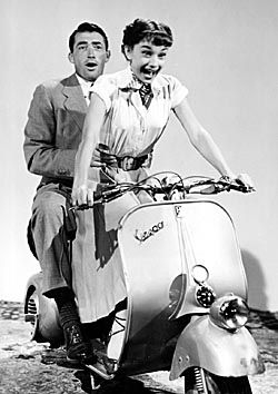 [Gregory Peck and Audrey Hepburn on a scooter in 'Roman Holiday.']