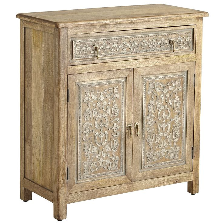 Henna designs are an ancient and beautiful form of body adornment in the eastern world. We traveled across the world for this exquisitely grained mango-wood cabinet with henna-style carvings, artfully whitewashed to show the intricate detail. Antique brass pulls on the top drawer and two lower doors; inside, a fixed shelf for storage. Imagine what you can do with it.