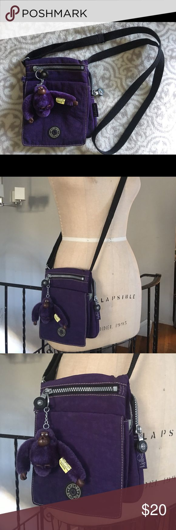Original Purple Kipling Raisin Cross Body Bag Very good used condition. Very minor discoloration on the front.  Only noticeable when looking for it. Original monkey key ring included. Kipling Bags Crossbody Bags