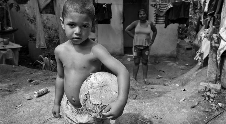 """At the Believers school we spent hours playing and dancing, laughing and hugging the children. They felt safe, happy and protected there. It made me wonder what life was like for them before they attended this school. (We had a glimpse of what life is like when we went to the Favela [Brazilian slum] """"I will never forget the boy who had gunshot scars on his stomach.) -Megan Wolfenden"""
