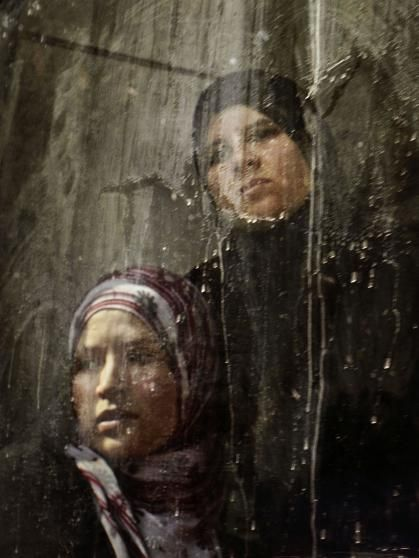 Two women look out from the window of a city train as it passes through downtown Tunis, Tunisia, Oct. 21, 2011.
