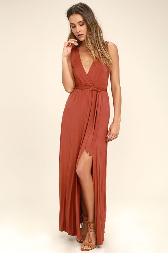 Adventure awaits in the Take a Cruise Rust Red Maxi Dress! Soft jersey knit shapes a plunging neck and back, and surplice bodice. Elasticized waist and tying sash top a full maxi skirt with sexy side slit.