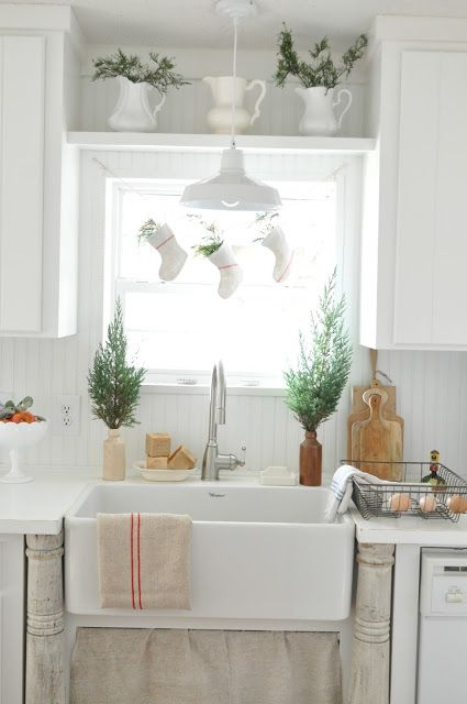 This rustic winter decor from Blogger Becky, of Buckets of Burlap, is a quick and easy way to decorate your home this holiday season. Becky used tons of natural greenery and miniature grainsack stockings to make her kitchen feel merry and bright. Click here to get more DIY design inspiration for the rest of your home.