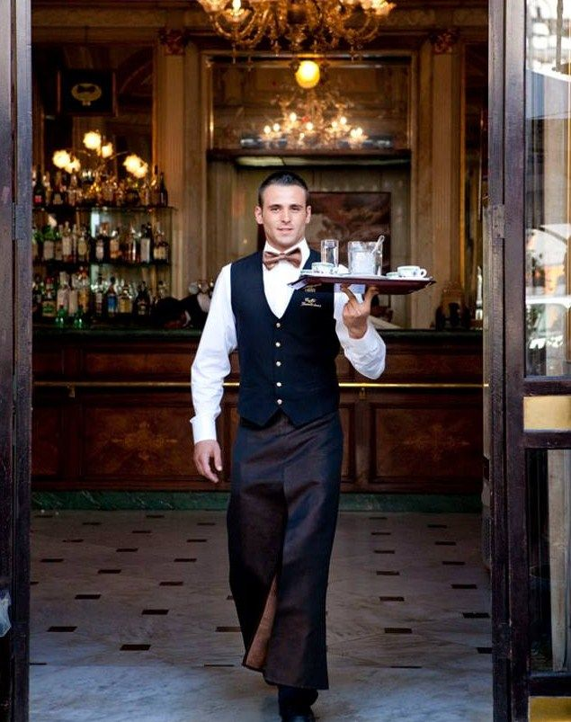 Example of Waiter at a fine dining wedding, plated service.  Somehow has apron pants.