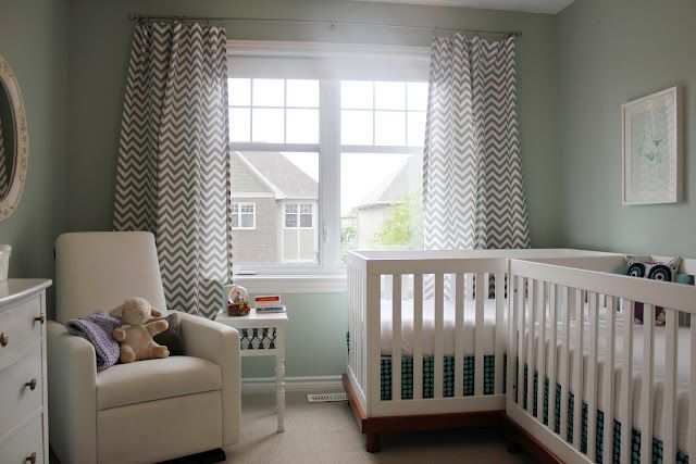 Twin nursery in a smaller room. Cute! And chevron curtains. Note crib placement!