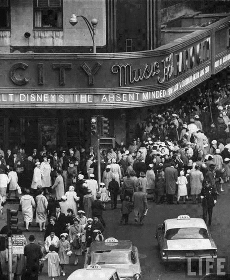 Crowds of people waiting to see Radio City Music Hall's Easter show. New York, 1961. Yale Joel for LIFE Magazine.