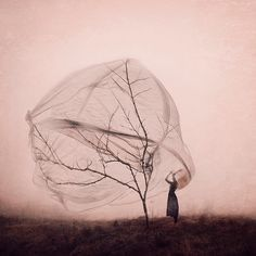 Tapping into unlived memories, Kylli Sparre (previously here and here) produces conceptual photographs that seem to be pulled from dark fairytales and otherworldly settings. The images are always focused on a lone woman in a dramatically staged pose, a reference to her past as a professionally train