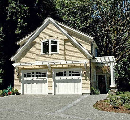 Custom windows and pergolas make this a well-designed addition to the property, providing garage space and an apartment.