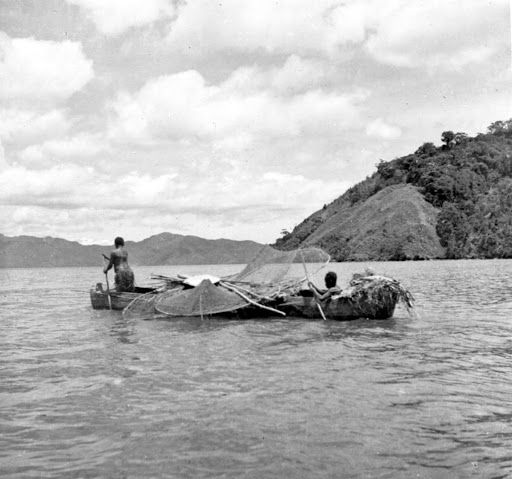 Papuans in a proa with nets used for lobster fishing - Google Arts & Culture