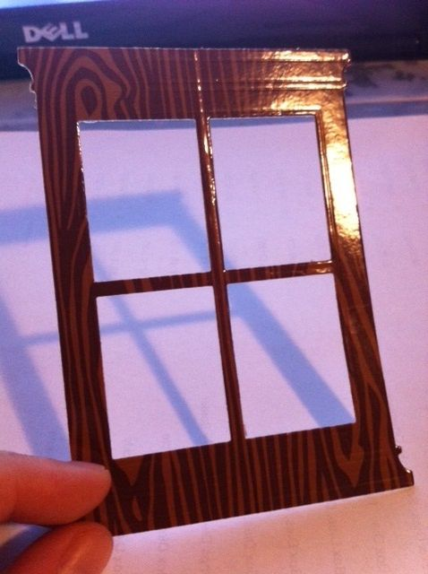 cover white cardstock with woodgrained duct tape then die cut with grand madison window die..look at that shine!!
