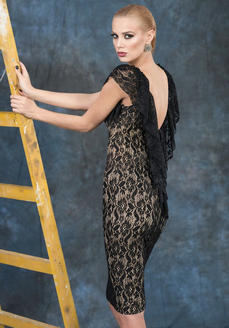 Midi lace dress with lycra lining. The dress has a plunging neckline in the black. The ruffles give the dress a