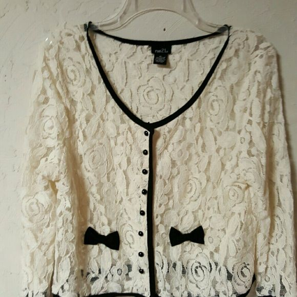 Lace and black dressy jacket Cream see thru  lace delicate jacket with black trim and bows on the side. Very dainty and cute the beaded buttons are real delicate and lose due to lace matetial Nice with black skirt or black dressy psnts Rue 21 Jackets & Coats Blazers