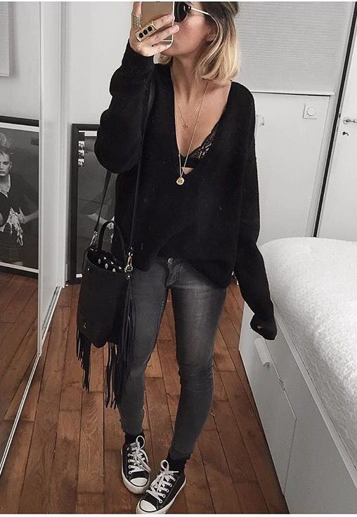 Grey jeans, converse, and black sweater