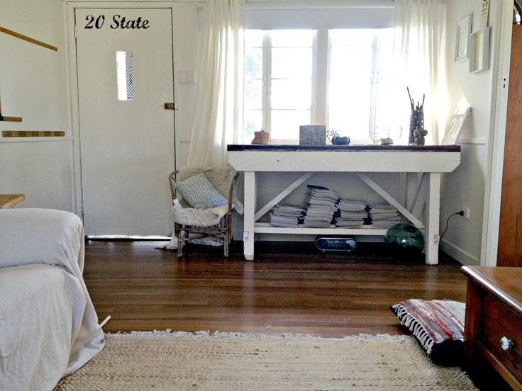 Small lounge room, white walls, hardwood floor