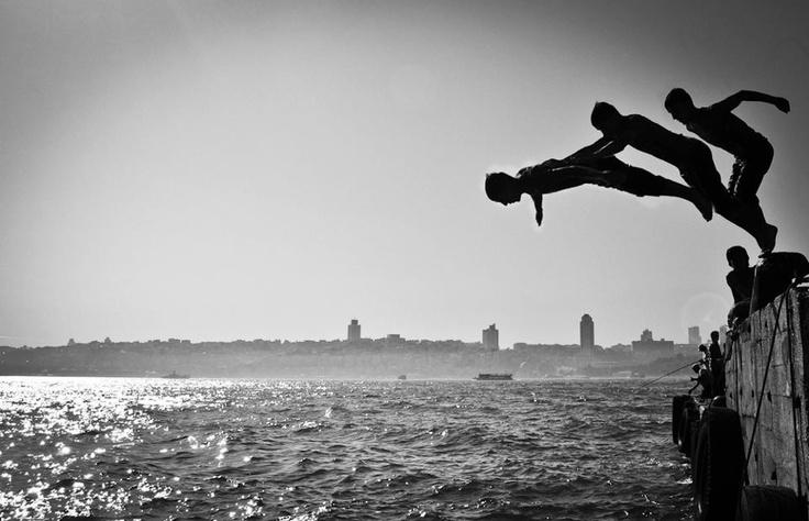 Kids jumping on Bosphorus by Ekrem Kalkan