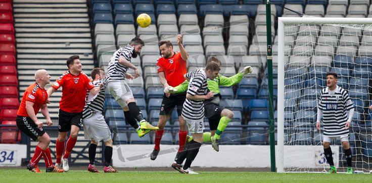 Queen's Park's Bryan Wharton wins the header during the SPFL League Two game between Queen's Park and Clyde