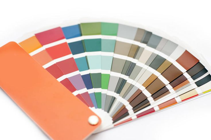 Free Stock Photo: Opened color chart for interior decorating or typography displayed fanned on a white background in a DIY and renovation concept - By freeimageslive contributor: freebie.photography