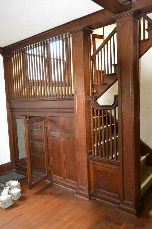 Staircase with built-in cabinets in a 1910 Arts & Crafts style house