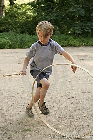 Playing stick and hoop July 2012 - YouTube